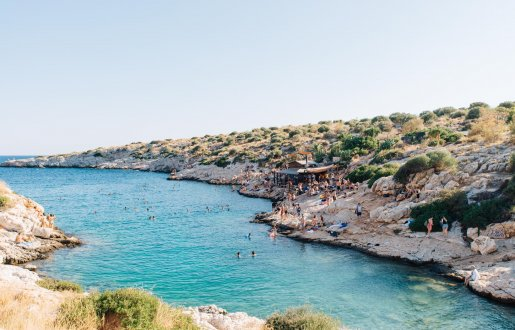 COOL REFRESHMENT - South of the long beaches at Little and Big Kavouri, the fingers of the Athens Riviera create dozens of small coves where Athenians take a dip and chill during the summer.